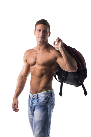 Shirtless muscular young man with backpack on his back