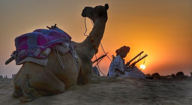 berber man with camel in desert