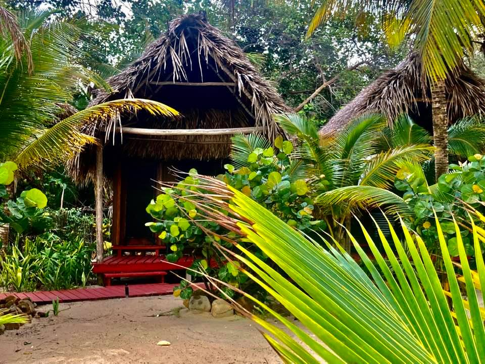 This image has an empty alt attribute; its file name is Singing-Sands-Inn-Placencia-Belize.jpg